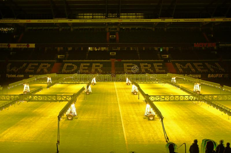 Weserstadion Bremen: Mobile grow lamps for lawn care. Weserstadion Bremen, Germany, December 16th, 2016: Mobile grow lamps for lawn care, lighting system in stock photography