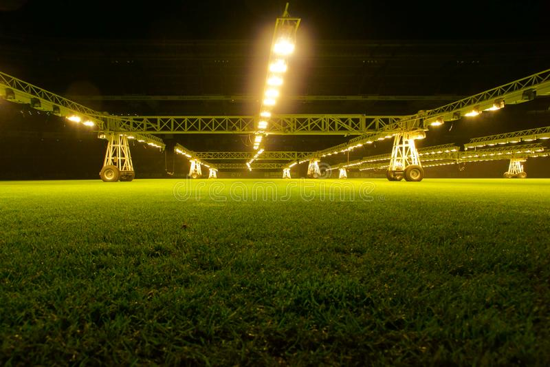 Weserstadion Bremen: Mobile grow lamps for lawn care. Weserstadion Bremen, Germany, December 16th, 2016: Mobile grow lamps for lawn care, lighting system in royalty free stock image
