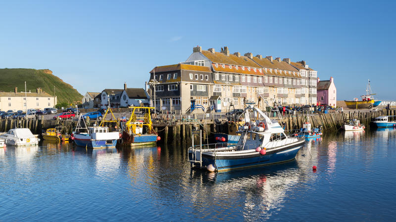 West Bay Dorset England. Fishing boats in West Bay Harbour Dorset England UK Europe stock photography