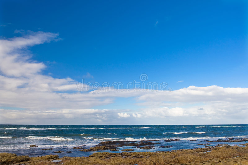 West Bay in Lossiemouth. West Bay with cloudy sky in Lossiemouth, Scotland royalty free stock images
