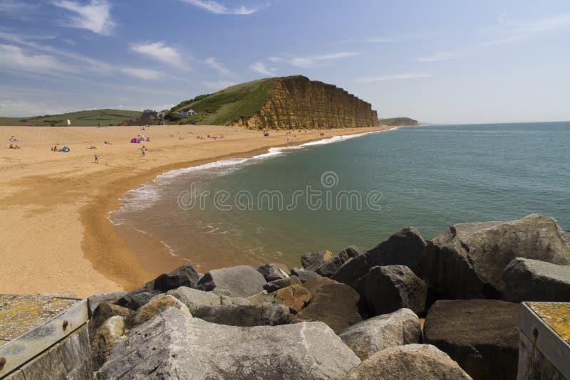 West Bay. Pebbled popular beach near Bridport, Dorset, England, United Kingdom. Used for TV show Broadchurch starring David Tennant and Olivia Colman stock photography