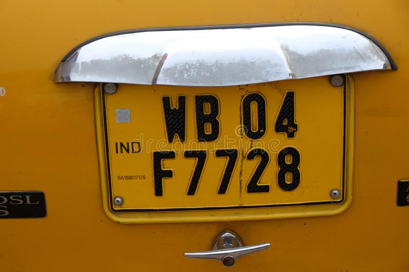 West Bengal license plate on a Ambassador car. Which are used as taxi on the streets of Kolkata, India on February 10, 2016 stock image