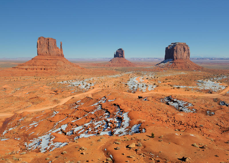 West, East & Merrick Buttes. West Mitten Butte (left), East Mitten Butte (center) and Merrick Butte at Monument Valley Tribal Park in Arizona in winter stock photo