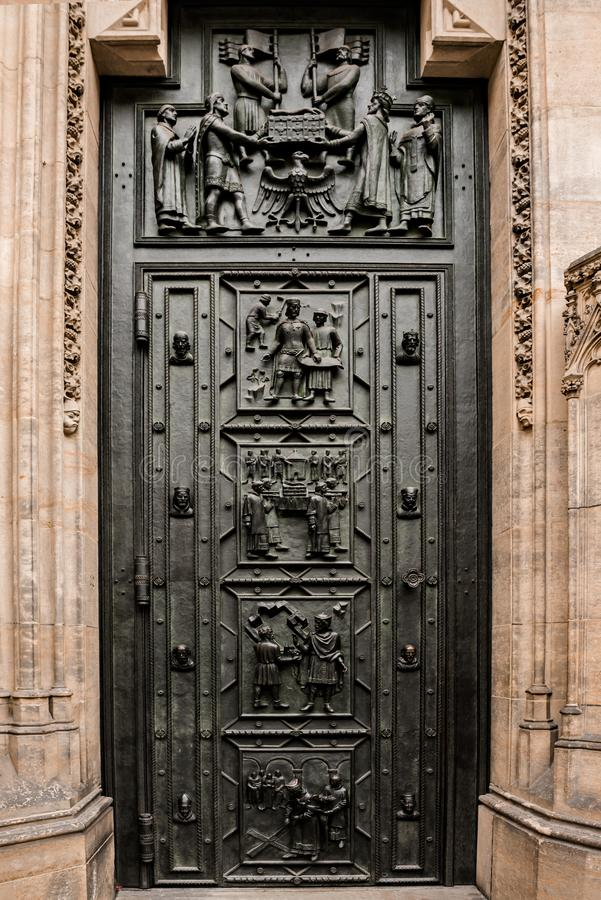West facade of the Cathedral of Saints Vitus built in the 14th century. Front door with decor, Prague, Czech Republic. Travel photography stock photos