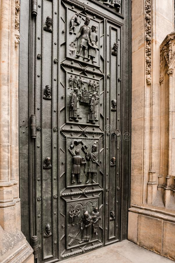 West facade of the Cathedral of Saints Vitus built in the 14th century. Front door with decor, Prague, Czech Republic. Travel photography stock photography