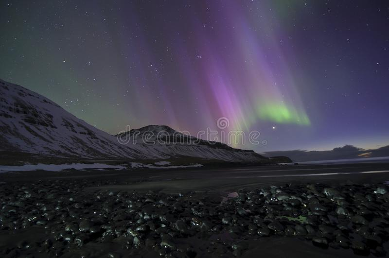 Orion and aurora borealis on Iceland west fjords beach stock photos
