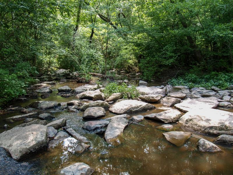 West Fork of the Little River. Along the trail at Pisgah Covered Bridge in Randolph County, North Carolina stock images