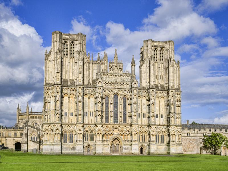 Wells Cathedral West Front UK. The West Front of Wells Cathedral and Cathedral Green, Wells, Somerset, England, UK. Wells Cathedral is considered to be one of royalty free stock images