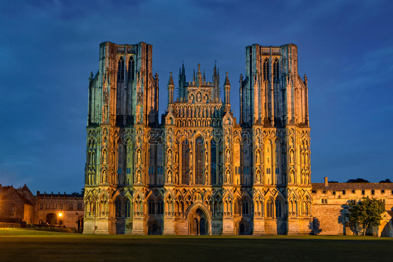 West front of Wells Cathedral at night. Wells, United Kingdom - August 13, 2016: West front of Cathedral Church of Saint Andrew at night. The Wells Cathedral was stock photo