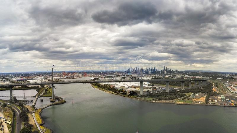 West Gate Bridge and Melbourne city. Australia, Melbourne - December 02, 2018: Aerial view of the West Gate Bridge and Melbourne city skyline with dark storm stock photography