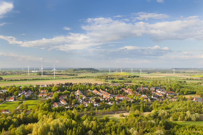 West German Wind Energy Landscape. Flat west German landscape near Aachen and Herzogenrath with lots of wind turbines and a village in the foreground royalty free stock photography