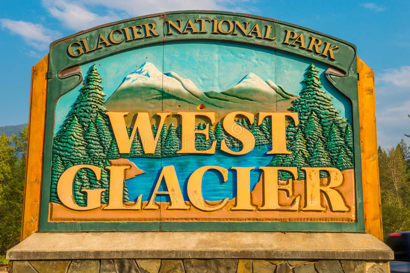 West Glacier sign Glacier National Park. At retail and Information area near the West Entrance to the Park stock photos