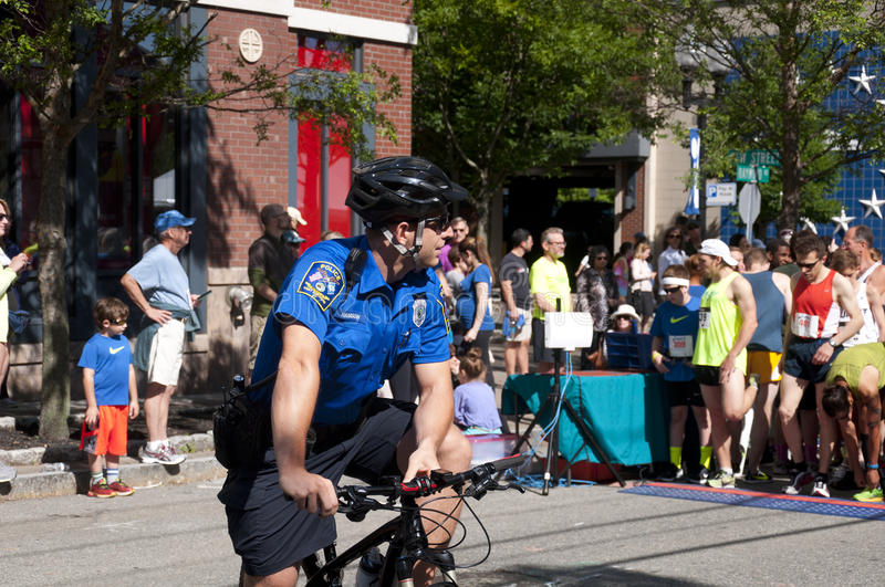 West Hartford Police Officer. A west hartford police officer on a bicycle on the road at the start of the West Hartford Connecticut annual 5k road race as