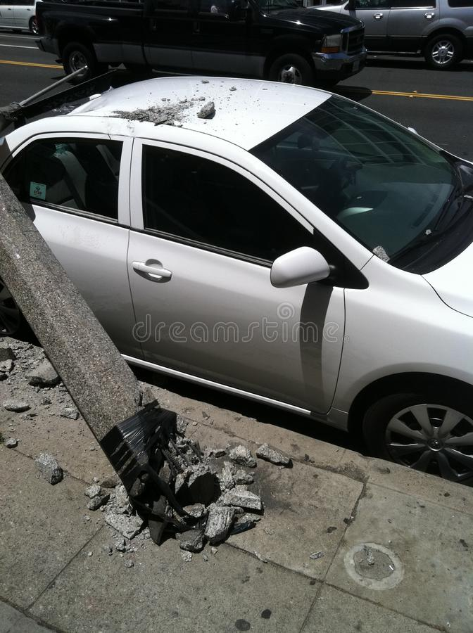 West Hollywood, CA / United States -  May 6, 2011: White Car hits light pole on street Sunset Blvd., West Hollywood with damage stock photography