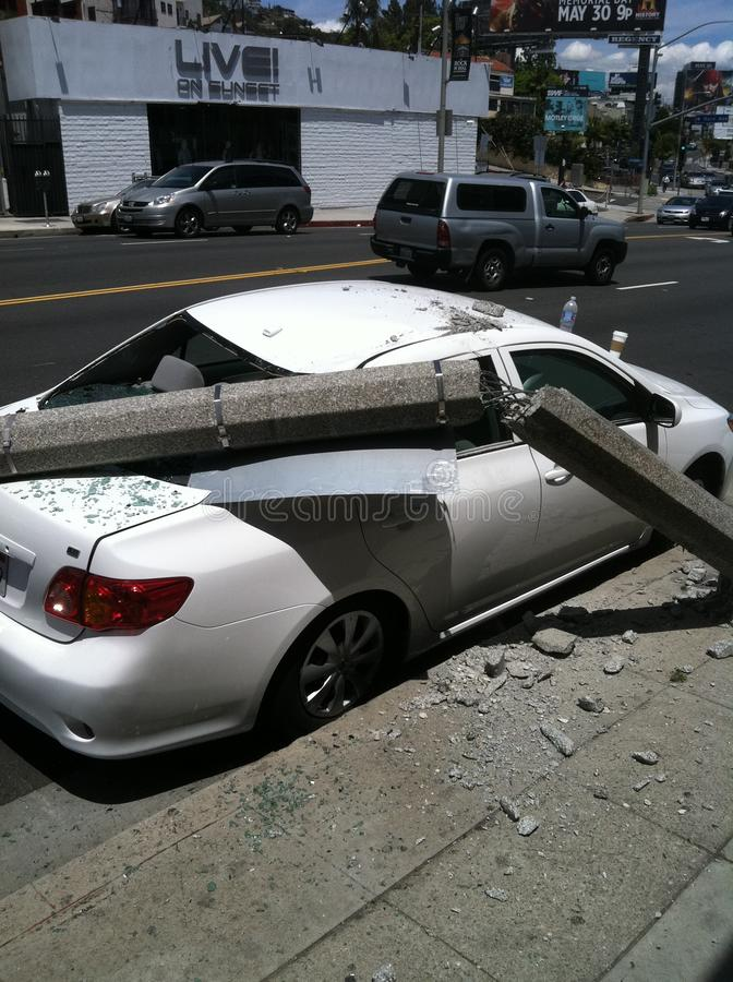 West Hollywood, CA / United States -  May 6, 2011: White Car hits light pole on street Sunset Blvd., West Hollywood with damage. To property . There was royalty free stock photo