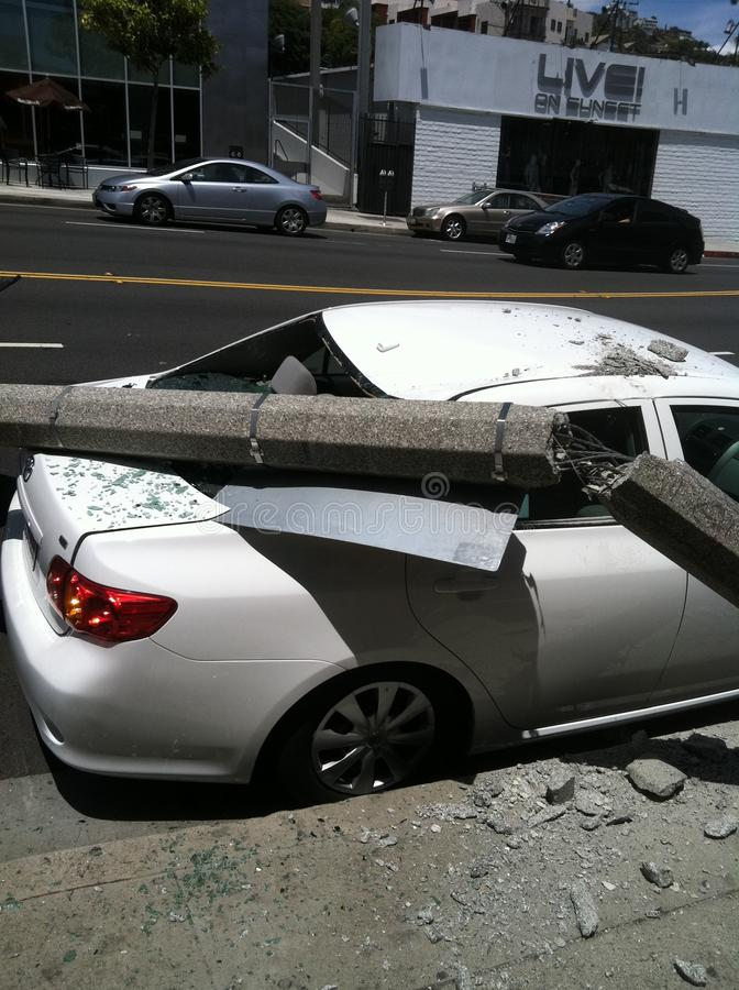 West Hollywood, CA / United States -  May 6, 2011: White Car hits light pole on street Sunset Blvd., West Hollywood with damage royalty free stock photos