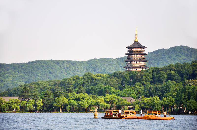 West lake hangzhou. Traditional ship on the West Lake Hangzhou, China. Leifeng Pagoda is a famous tower in West Lake.This pagoda is famous by a old love story stock photography
