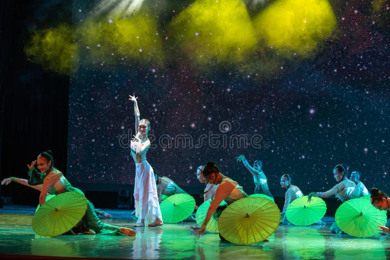 Tea plucking girl-In the spring of the west lake-Chinese classical dance. By the west lake in hangzhou, a pair of graceful young girls came to pick mulberry stock image