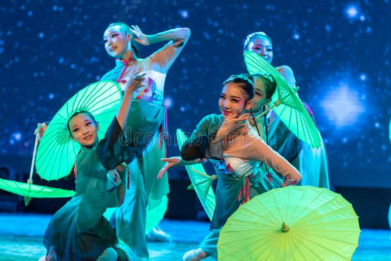 Oiled paper umbrella-In the spring of the west lake-Chinese classical dance. By the west lake in hangzhou, a pair of graceful young girls came to pick mulberry stock photo