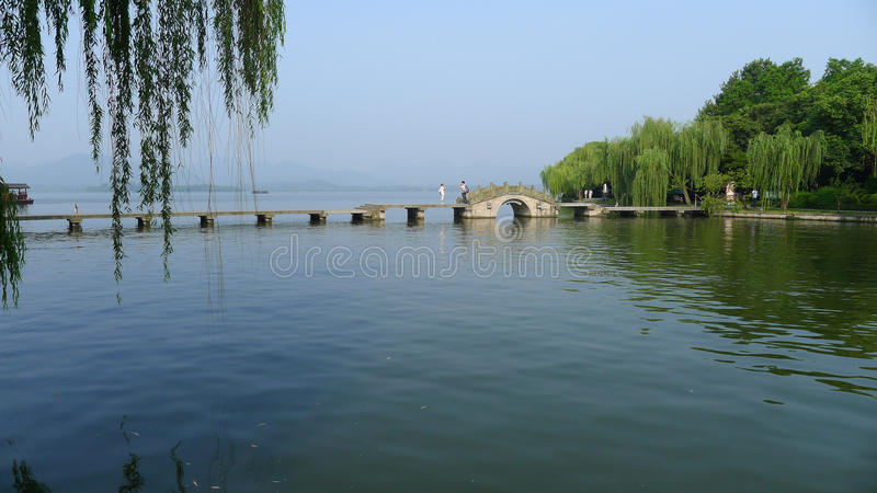 West lake with stone bridge royalty free stock photo