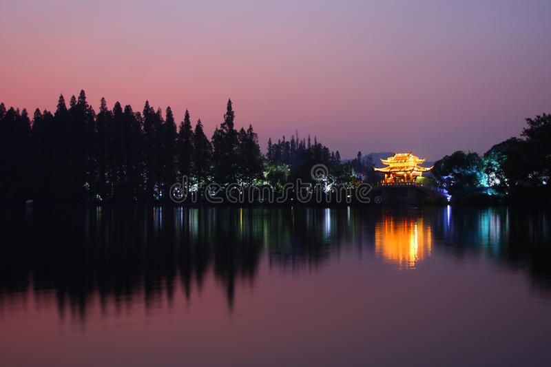 Download West lake in sunset stock photo. Image of dimming, pink - 16391544
