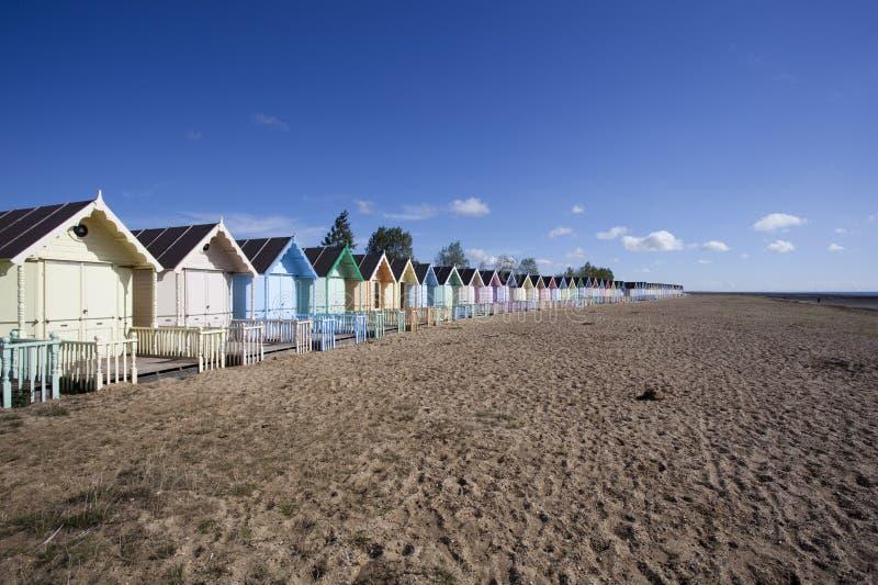 West Mersea Beach, Essex, England. Colourful beach huts at West Mersea, Essex, England royalty free stock image