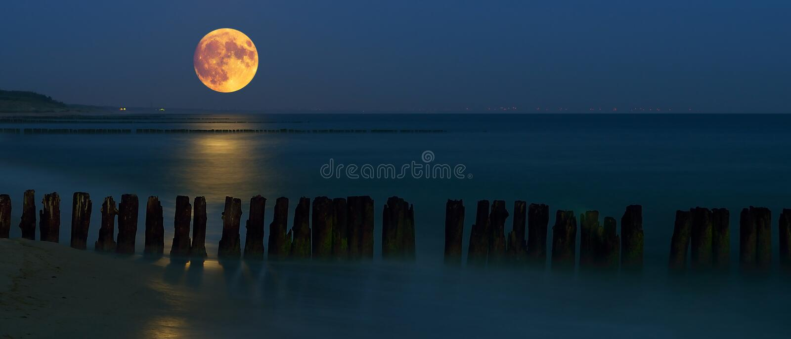 West of the moon over the sea royalty free stock photo