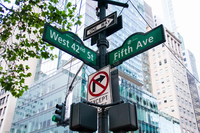 West 42nd Street, Fifth Ave, One way, No turn signs and traffic light on the pole, New York. West 42nd Street, Fifth Ave, One way, No turn signs and traffic royalty free stock photography