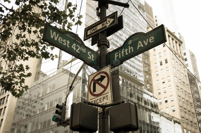 West 42nd Street, Fifth Ave, One way, No turn signs and traffic light on the pole in old vintage style. Manhattan, New York stock images