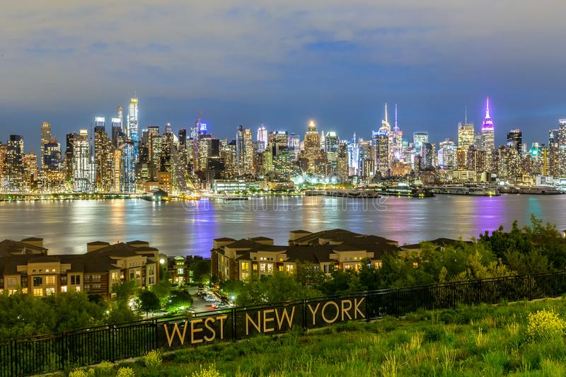 West New York City midtown Manhattan skyline view from Boulevard East Old Glory Park over Hudson River at dusk. stock image