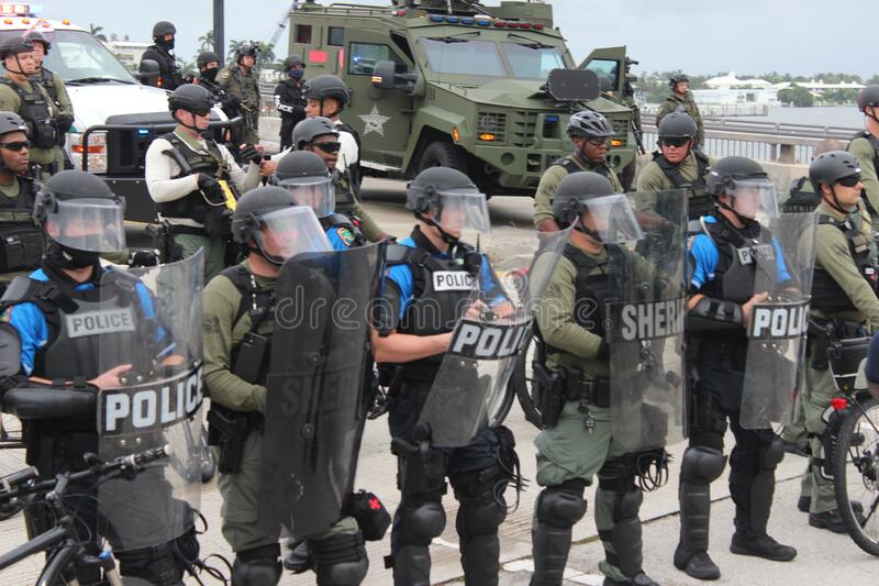 Protesting the death of George Floyd in West Palm Beach, Florida. WEST PALM BEACH, FL- JUNE 02: Police hold a perimeter near Mar-a-Lago as demonstrators gather stock photos