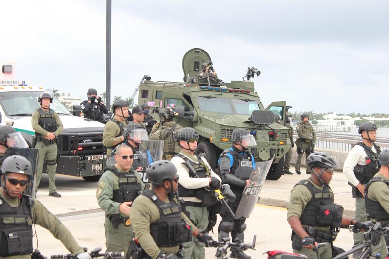 Protesting the death of George Floyd in West Palm Beach, Florida. WEST PALM BEACH, FL- JUNE 02: Police hold a perimeter near Mar-a-Lago as demonstrators gather stock image