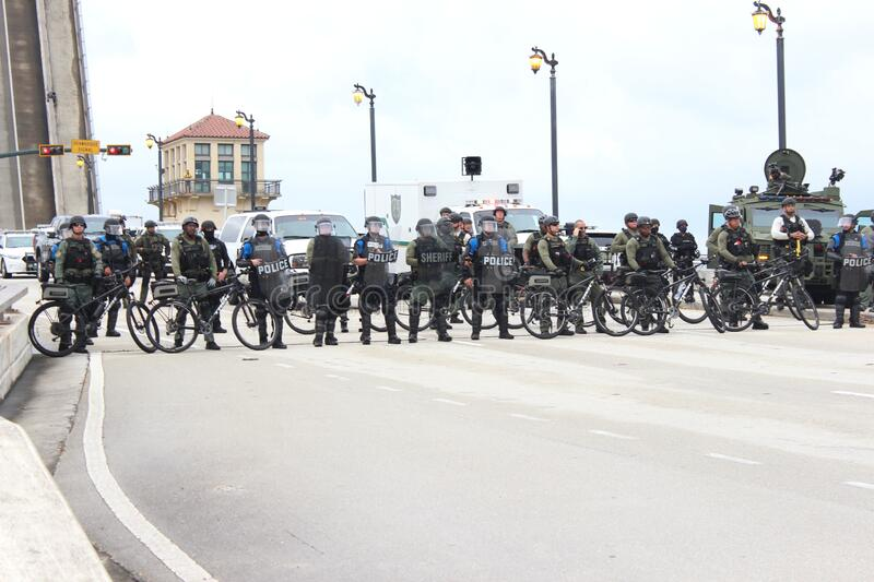 Protesting the death of George Floyd in West Palm Beach, Florida. WEST PALM BEACH, FL- JUNE 02: Police hold a perimeter near Mar-a-Lago as demonstrators gather stock images
