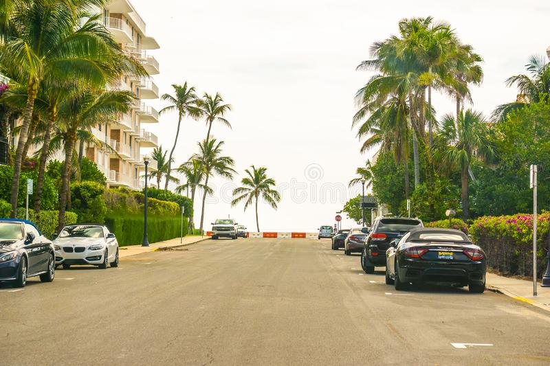 WEST PALM BEACH, Florida -7 May 2018: The road with cars at Palm Beach, Florida, United States. WEST PALM BEACH, Florida -7 May 2018: The road with cars at Palm stock photos