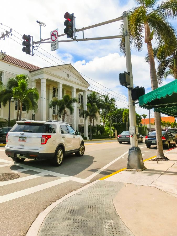 WEST PALM BEACH, Florida -7 May 2018: The road with cars at Palm Beach, Florida, United States. WEST PALM BEACH, Florida -7 May 2018: The road with cars and royalty free stock photos