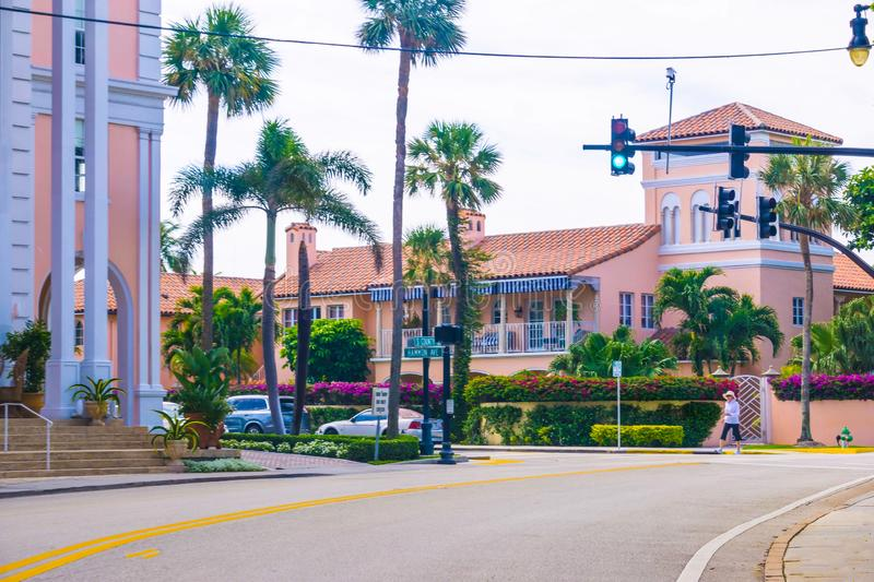 WEST PALM BEACH, Florida -7 May 2018: The road with cars at Palm Beach, Florida, United States. WEST PALM BEACH, Florida -7 May 2018: The road with cars at Palm stock images