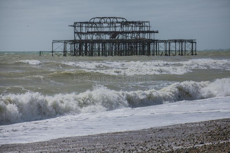 West Pier, Brighton, England - the waves and the sky. This image shows a view of the West Pier. The West Pier is a pier in Brighton, England, the UK. It was stock photo