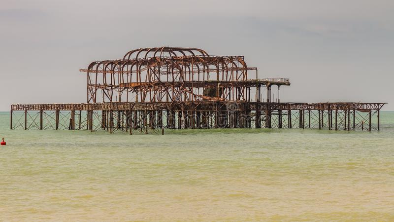 West Pier, Brighton, UK. The remains of West Pier, seen from Brighton Beach, East Sussex, England, UK royalty free stock photos