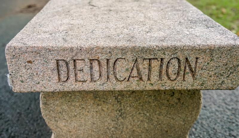 The West Point Dedication bench. West Point Military Academy bench inscribed with the word Dedication royalty free stock images