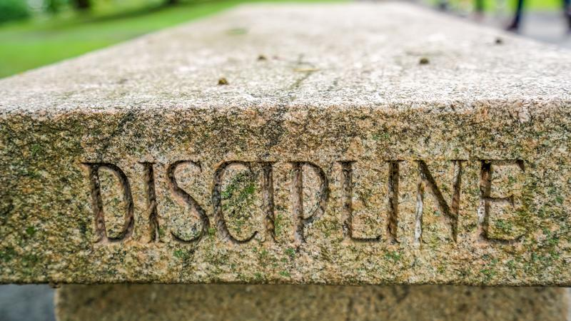 The West Point Discipline bench. The West Point Military Academy bench inscribed with the word motto Discipline stock image