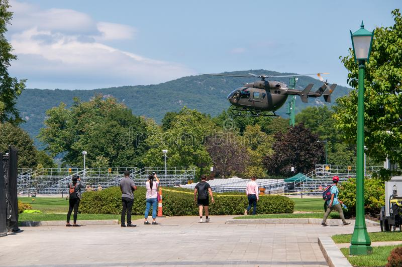 Army military helicopter approaching the West Point parade field in preparation for landing. West Point, New York - August 30, 2019: Army military helicopter was stock images