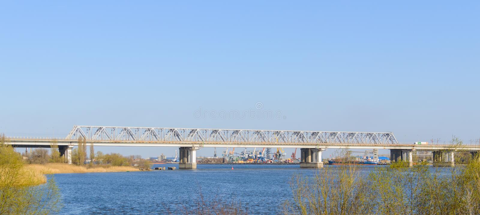 West railroad bridge above river Don. Industrial port on background royalty free stock images