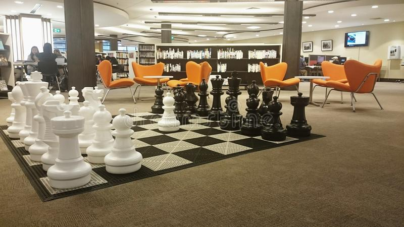 West Ryde Library. Modern and beatuful community library in West Ryde, Sydney Australia. Huge chess and chessboard are on the floor royalty free stock photos