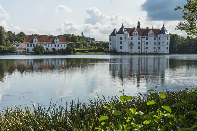 West side of Gluecksburg Castle with pond, Schleswig-Holstein, Germany royalty free stock image