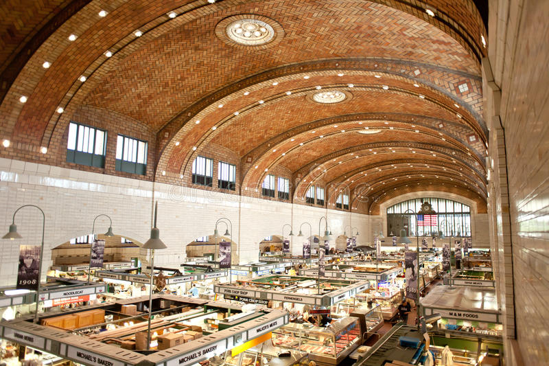 West side market in cleveland. CLEVELAND, OH – AUGUST 6, 2014: Customers and tourists shopped at West Side Market in Cleveland, Ohio in the late morning stock image