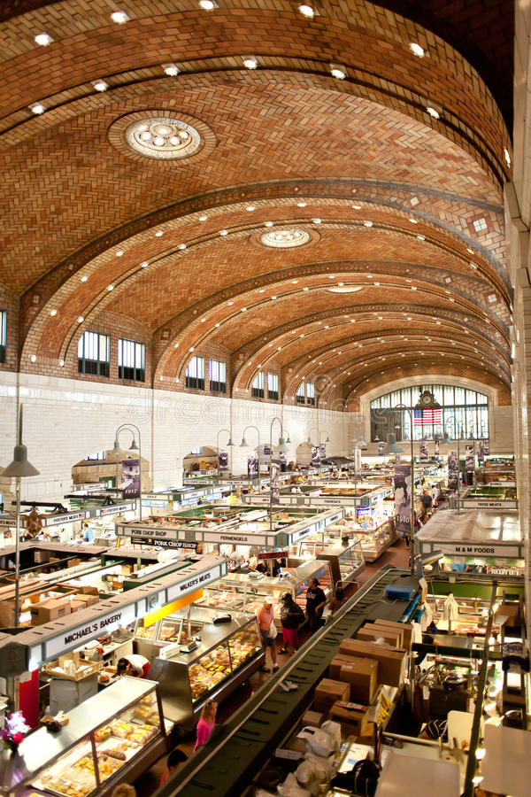West side market in cleveland. CLEVELAND, OH – AUGUST 6, 2014: Customers and tourists shopped at West Side Market in Cleveland, Ohio in the late morning stock photos