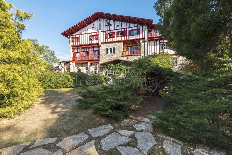 The west side of Villa Arnaga in Cambo-les-Bains, as seen from the park walk pass, typical house of neo Basque style in French royalty free stock photo