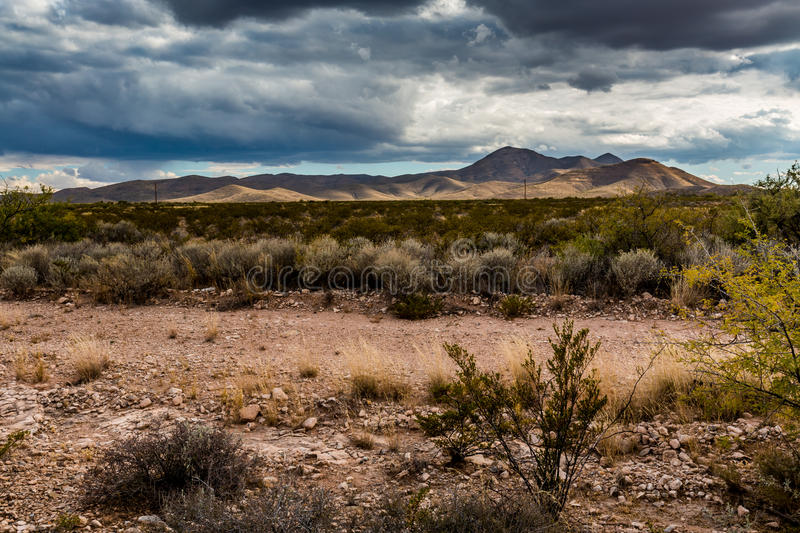 West Texas Landscape of Desert Area with Hills. Far West Texas Landscape of Desert Area with Hills, Clouds, and Desert Plants stock image