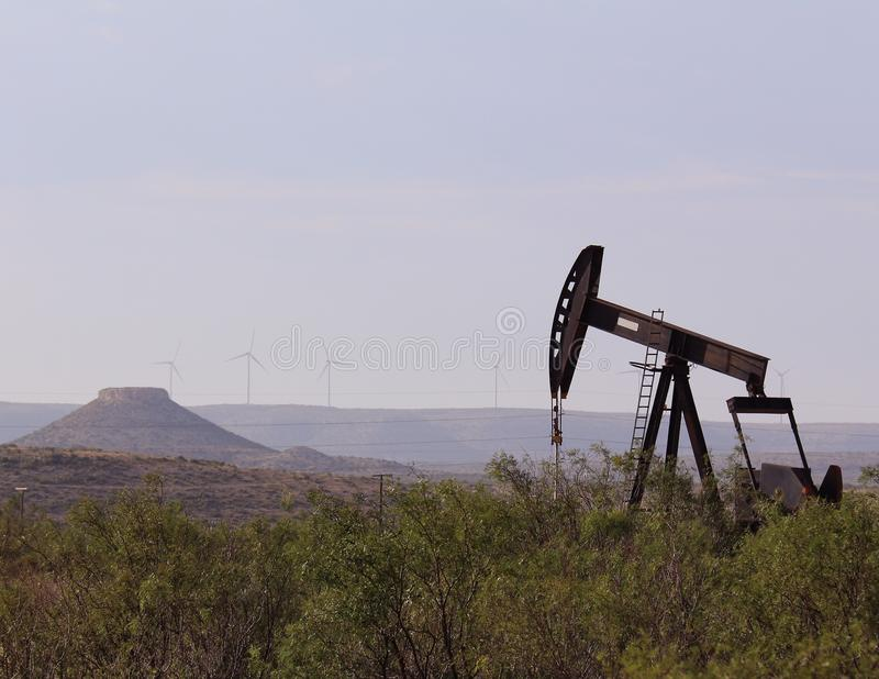 West Texas Pump Jack with Mesa royalty free stock image
