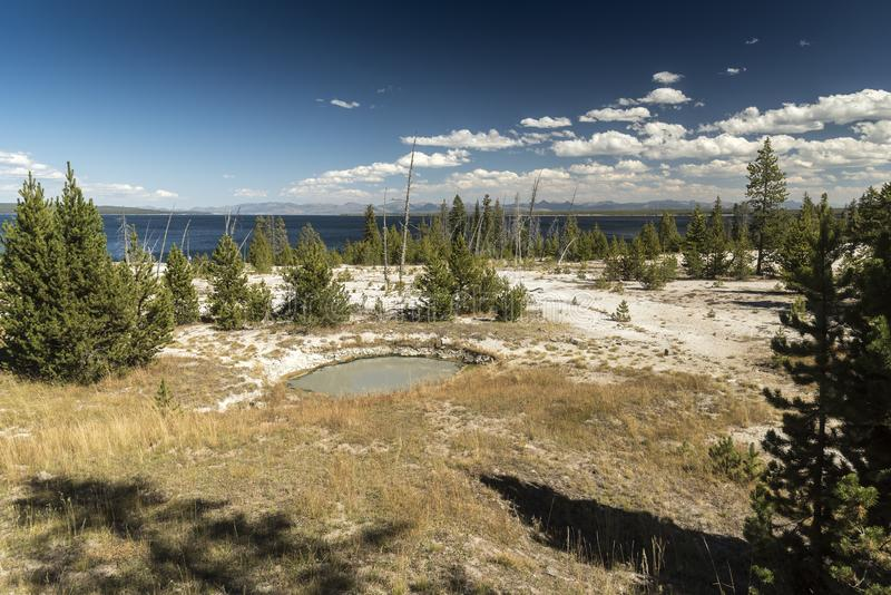 West Thumb Geyser Basin Yellowstone National Park. This small, colorful geyser in Yellowstone National Park also features scenic lake views royalty free stock image